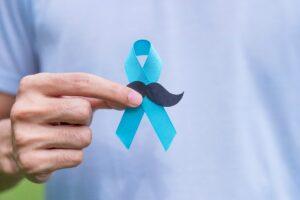 November Prostate Cancer Awareness month, adult Man holding Blue